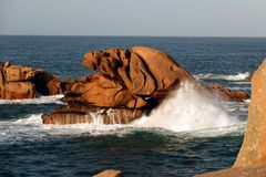 High waves at Pink Granite rock coast in Brittany. Côte de Granit Rose is one of the most beautiful stretches of Brittany's coastline. The unusual rock stock photo
