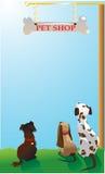 Cães sob o quadro indicador da loja de animais de estimação Foto de Stock Royalty Free