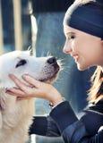 Cão com menina Imagens de Stock Royalty Free