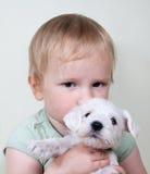 Cão da criança e de cachorrinho Imagens de Stock