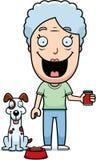 Cão de alimentação da mulher dos desenhos animados Imagem de Stock