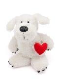 Cão de brinquedo macio com pouco coração Fotografia de Stock
