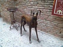 Cão de bronze Fotografia de Stock