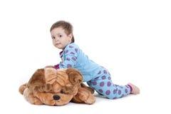 Cão do menino e de brinquedo Fotografia de Stock