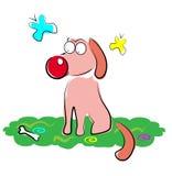 Cão em uma grama Fotos de Stock Royalty Free