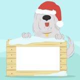 Cão no chapéu do ` s de Santa que guarda uma superfície de madeira com uma placa para seu texto ilustração royalty free