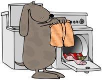 Cão que faz a lavanderia Imagens de Stock