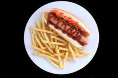 Cão quente com fritadas Foto de Stock Royalty Free