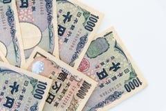 Cédula japonesa dos ienes da moeda no fundo branco Imagem de Stock
