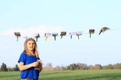 Cédulas de secagem da menina Imagens de Stock Royalty Free