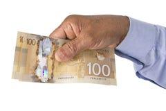 Cédulas do dólar canadense no fundo branco Foto de Stock Royalty Free