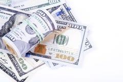 Cédulas do dólar em um fundo branco Fotografia de Stock Royalty Free