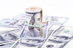 Cédulas do dólar em um fundo branco Imagens de Stock