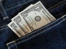 Cédulas do dólar no bolso das calças de brim Foto de Stock Royalty Free
