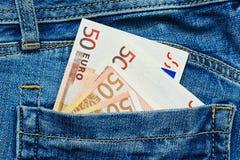 Cédulas do Euro no bolso de calças traseiro Imagem de Stock Royalty Free