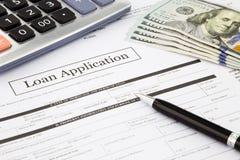 Cédulas do formulário e do dólar de pedido de empréstimo Fotografia de Stock