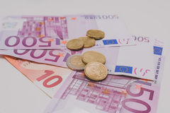 Cédulas e moedas de Uro Imagens de Stock