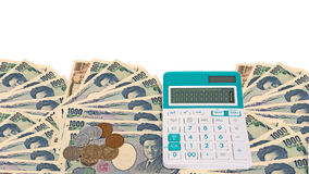 cédulas japonesas dos ienes da moeda com moeda do iene japonês e calc Imagens de Stock Royalty Free