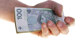 Cédulas polonesas da moeda cem zloty empilhados à disposição fotos de stock royalty free