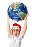 Célébrant Noël autour de la planète dans le monde entier Images libres de droits