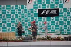 Célébration 2010 de victoire de Sepang de la formule 1   Photographie stock libre de droits