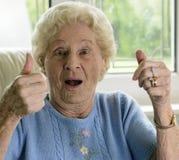 Célébration de dame âgée image stock