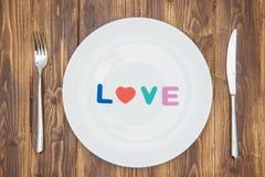 Célébrez le jour de valentine, amour de mot d'un plat Photos stock