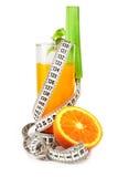 Céleri de jus d'orange et bande de mesure images libres de droits