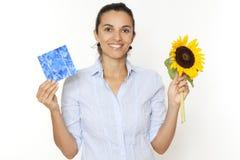 Célula solar do girassol da mulher Fotografia de Stock Royalty Free