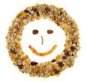 Céréale de petit déjeuner heureuse de visage d'isolement sur un fond blanc Images stock