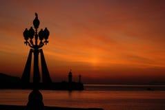 Céu do fundo do Grunge no por do sol no mar Imagem de Stock Royalty Free