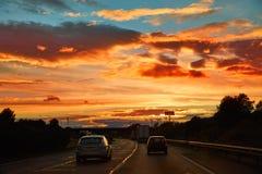 Céu do por do sol no autovia da estrada AP-7 Foto de Stock Royalty Free