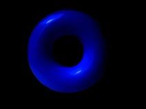 Círculo azul plástico em um fundo preto Foto de Stock Royalty Free