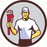 Círculo de Holding Monkey Wrench del fontanero retro libre illustration