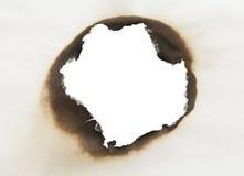 Círculo de papel quemado imagen de archivo