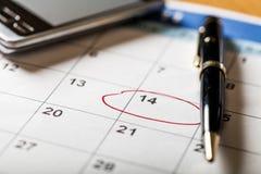 Círculo marcado em um conceito do calendário para fotos de stock