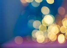 Círculos amarelos abstratos de Bokeh no fundo borrado fotografia de stock royalty free
