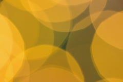 Círculos amarillos borrosos de la luz de la Navidad Imagen de archivo libre de regalías