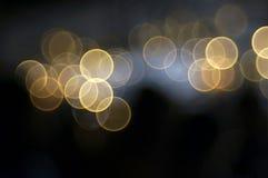 Círculos amarillos en un fondo oscuro fotografía de archivo libre de regalías