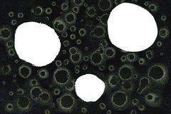 Círculos blancos en textura oscura Imagenes de archivo