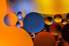 Círculos coloreados de aceite/agua Extracto de la macro Fotos de archivo