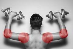 Círculos coloreados pero tensión en peligro del músculo Foto de archivo libre de regalías