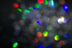 Círculos coloridos do fundo abstrato claro Textura do feriado Pontos claros coloridos do brilho no contexto cinzento foto de stock