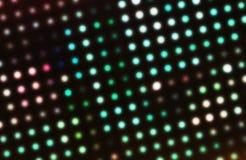 Círculos de incandescência abstratos em um fundo colorido fotografia de stock