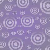 Círculos de prata em um fundo do lilac Fotos de Stock