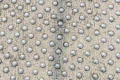 Círculos do metal em uma superfície do cimento Fotografia de Stock