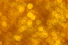 Círculos dourados de Bokeh em Trapnsparency imagens de stock royalty free