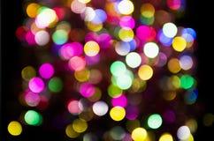 Círculos festivos borrados coloridos multicoloridos do bokeh imagem de stock royalty free