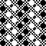 Círculos grandes y pequeños, blancos y negros en cuadrados Foto de archivo