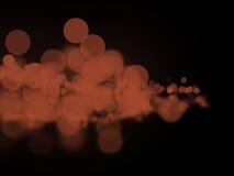 Círculos marrones abstractos de un bokeh en oscuridad foto de archivo